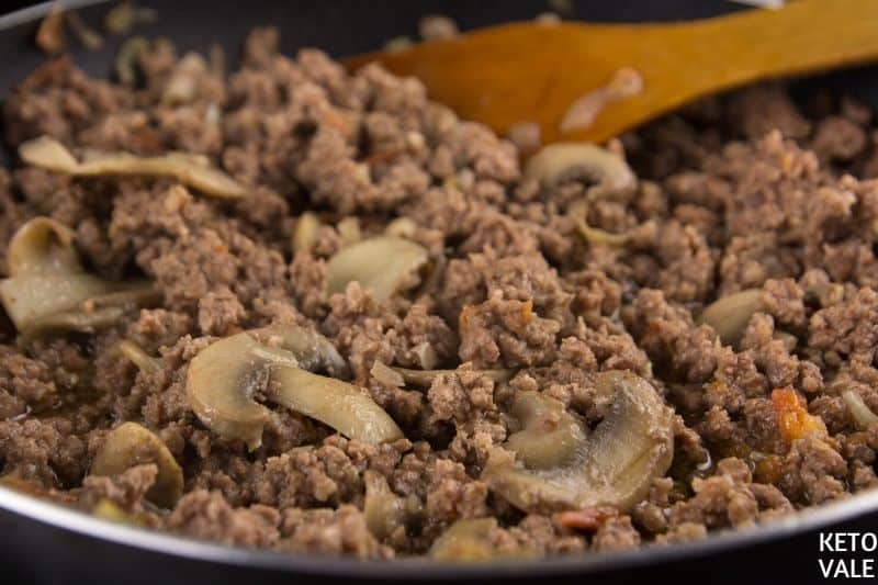 add tomatoes and ground beef