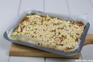 Topping with grated cheddar cheese