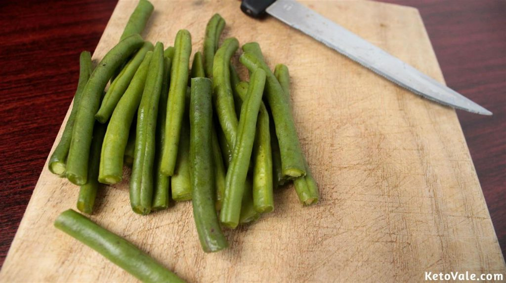 Cutting green beans in half