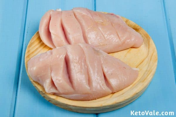 Cutting slits in chicken