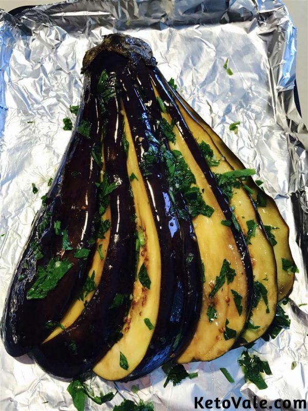 Season eggplant with olive oil