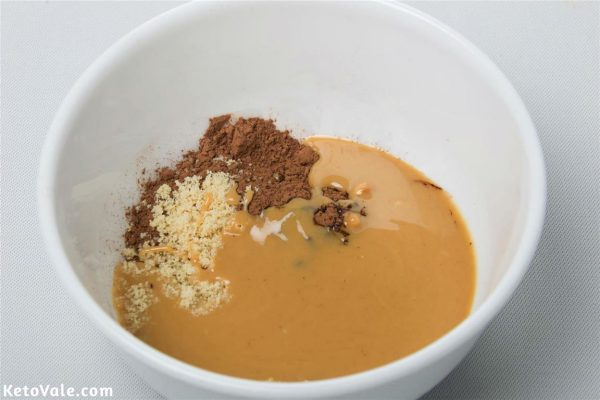 Mix cocoa powder, peanut butter and almond