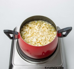 Add cauliflower, cheese, broth