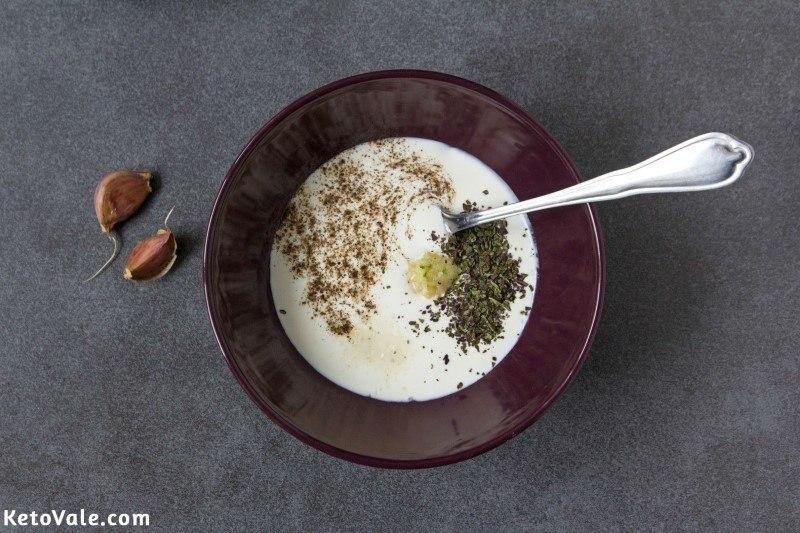 Mix sour cream, garlic, basil, salt and pepper