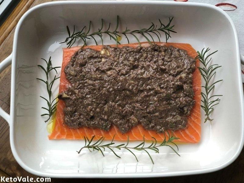 Pour tapenade over salmon