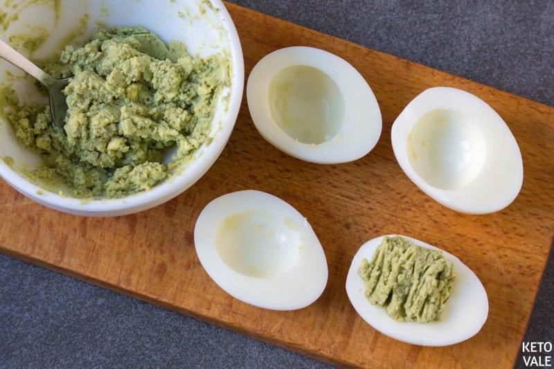 Scoop avocado mixture back into egg