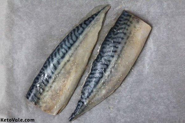 Season mackerel fillets with salt pepper oil