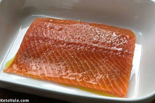 Season salmon with olive oil salt pepper