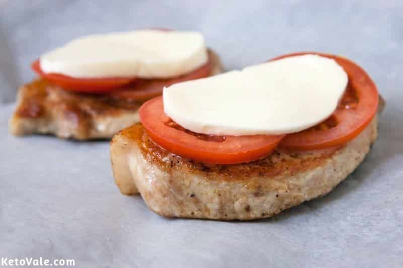 Top with tomato slices and cheese