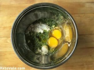 Mix basil with almond flour, flax meal, egg