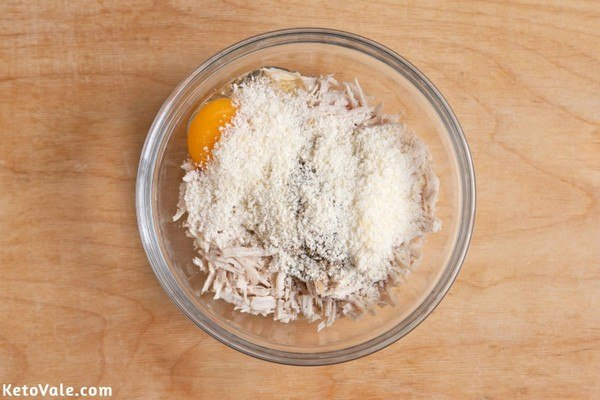 Mix chicken, egg, spices cheese