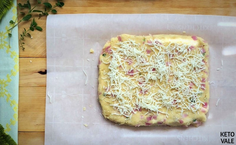 Sprinkle cheese on scone dough