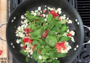 Saute cauliflower, spinach, tomatoes in butter