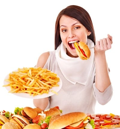 woman eats junk foods