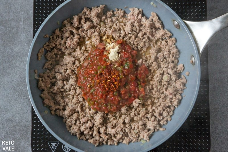 add salsa and spices to beef