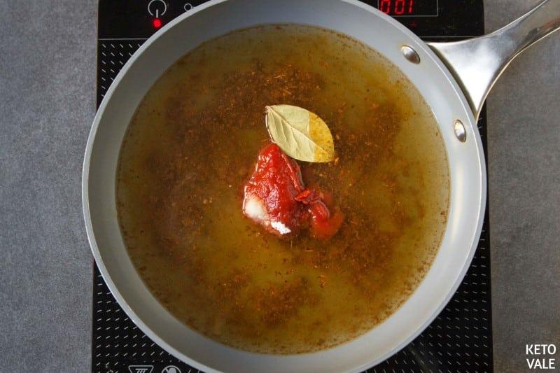 add tomato paste and bone broth