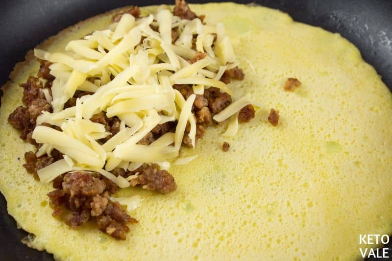 top pork and cheese on omelet