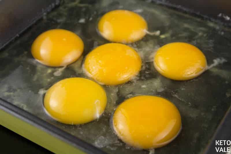 pour eggs in greased pan