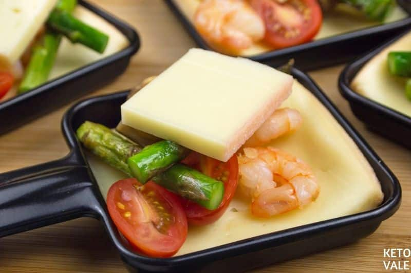 topping with raclette cheese