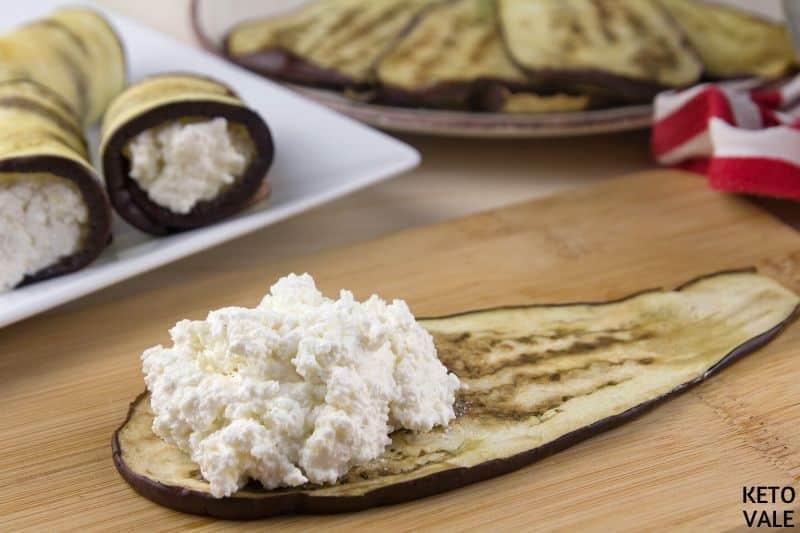spoon cheese mixture eggplant slices