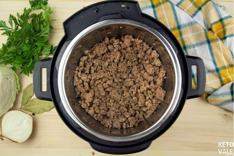 add ground beef in onion