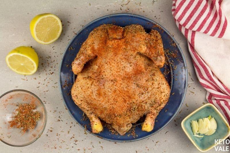 rub spices on chicken