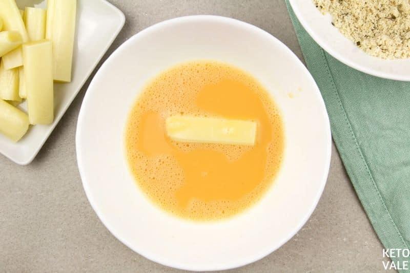 dip mozzarella sticks in egg